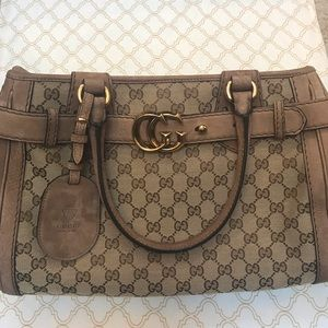 Authentic Gucci Monogram and leather satchel